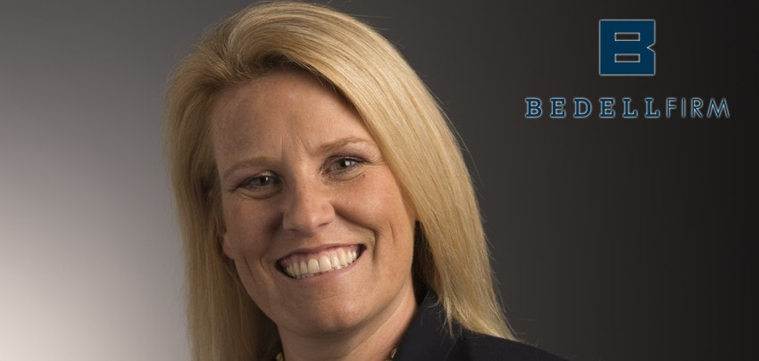 Ashley Wells Cox smiles. The blue Bedell Firm logo is to her right